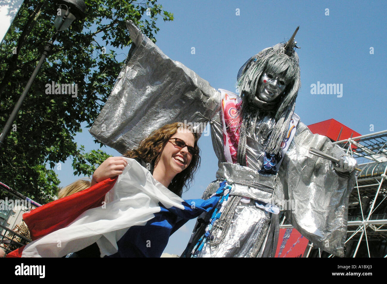 tourist and street theatre artist smiling at camera Paris France - Stock Image