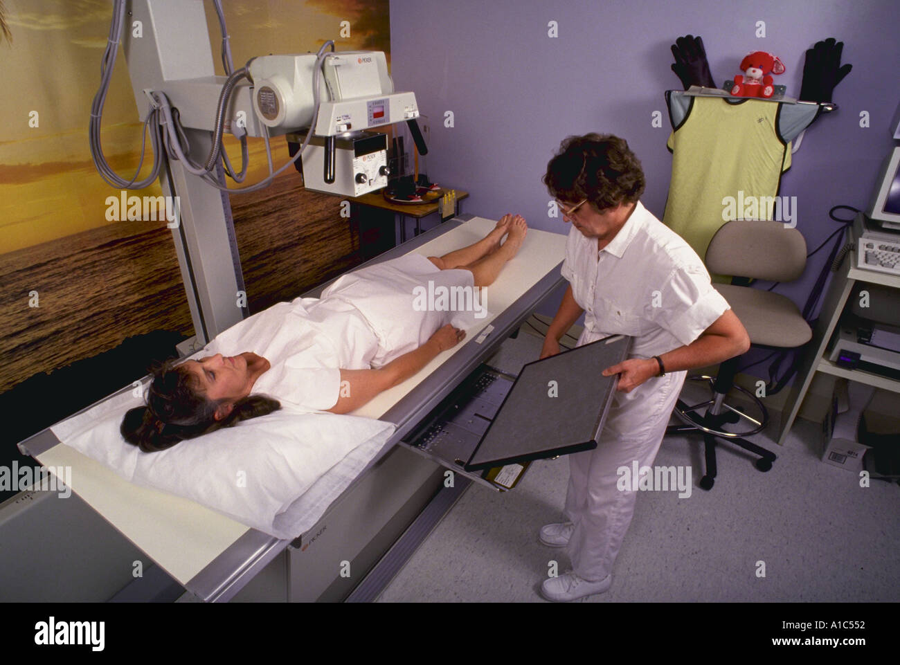 Technician prepares to x ray a patient lower back at the Primus Clinic in Burke Virginia model released - Stock Image