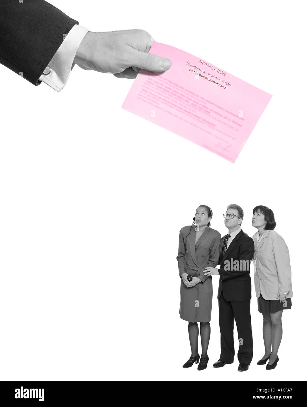 Giant hand delivering pink slip to workers - Stock Image