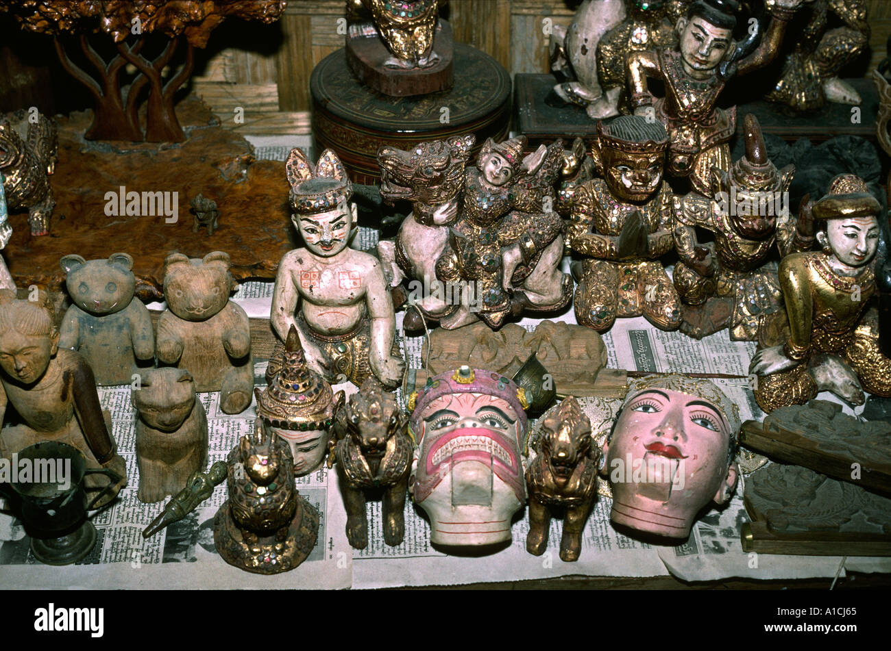 Myanmar Burma Mandalay crafts selection of old and new carvings by Winn Myint Stock Photo