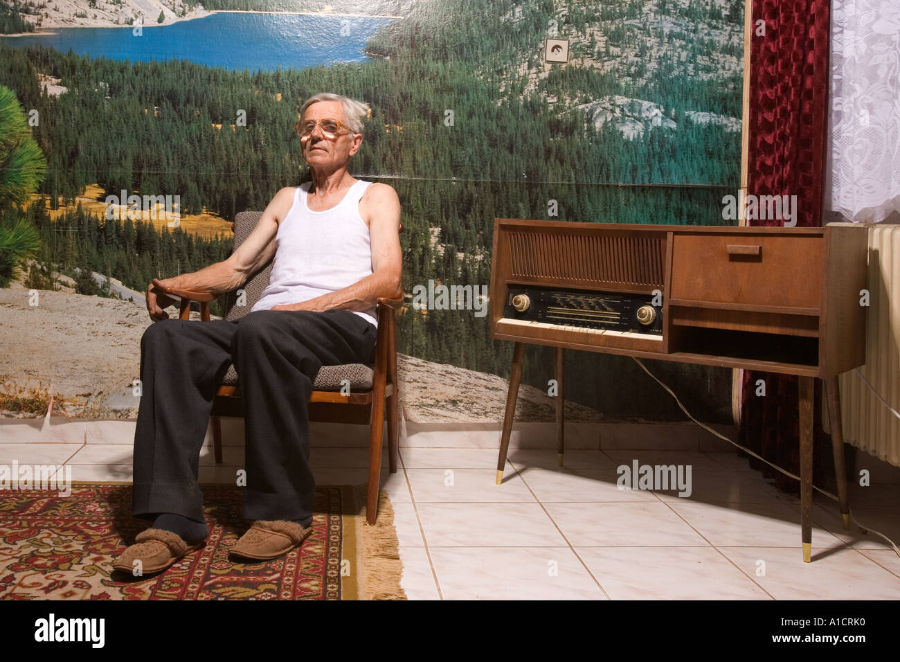 Old Man Sitting In Front Of House Stock Photos & Old Man Sitting In ...