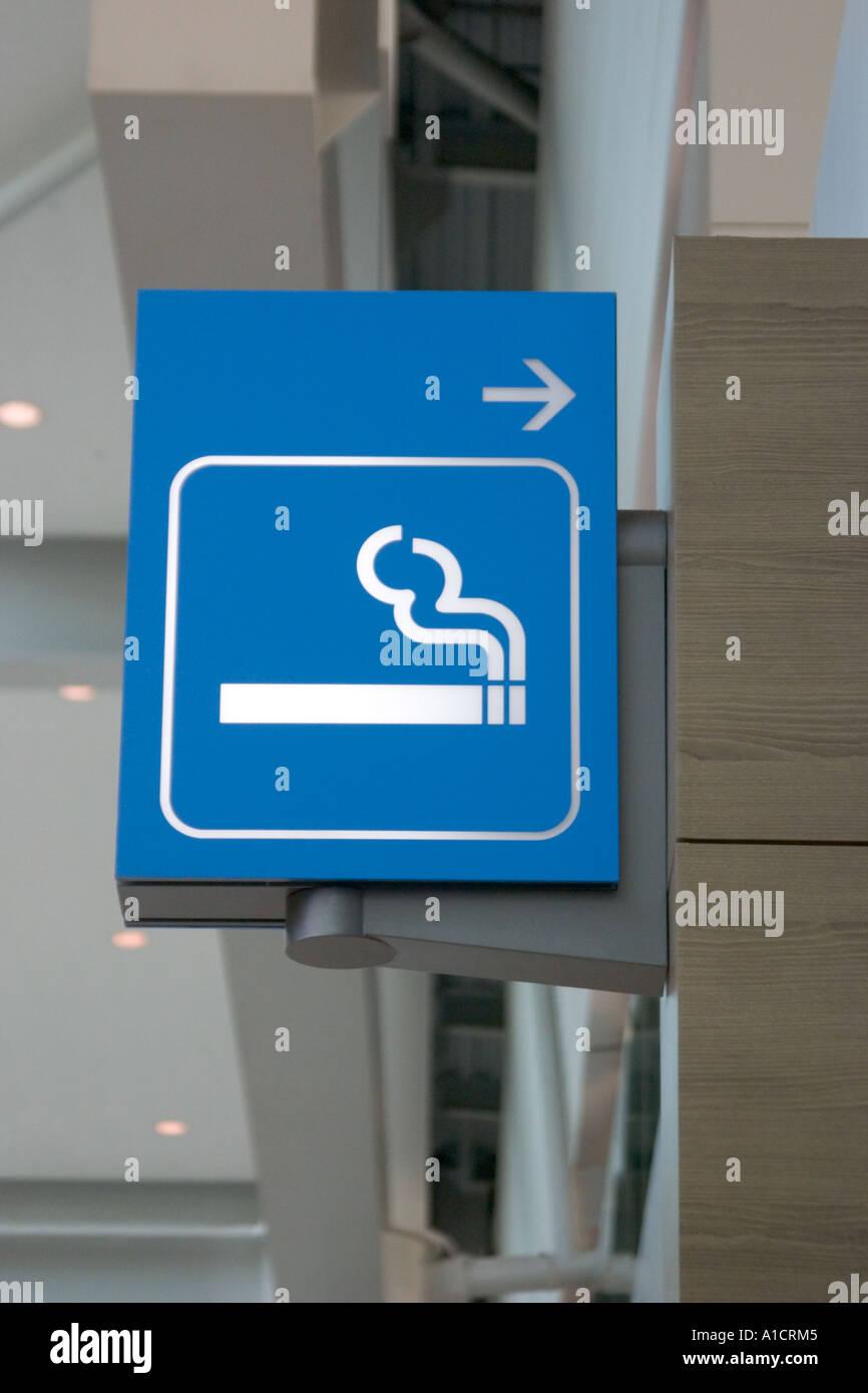 Airport sign indicating a smoking area at Incheon International Airport South Korea AsiaStock Photo