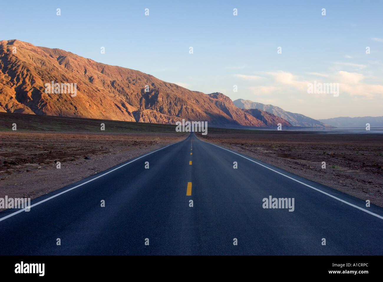 Long stretch of desert road in Death Valley National Park California United States of America Stock Photo