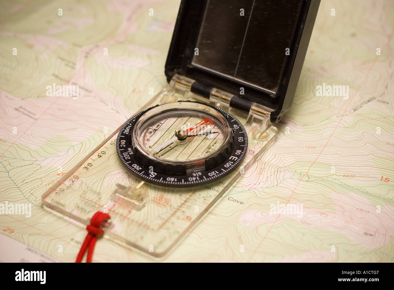 A compass and USGS topographic mapStock Photo