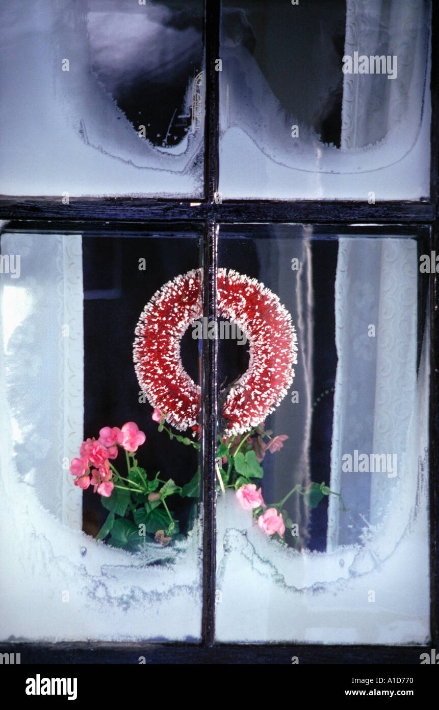 A frosty window at Christmastime - Stock Image