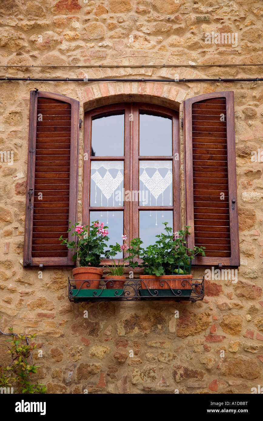 A window and window box with flowers. Tuscany Italy - Stock Image