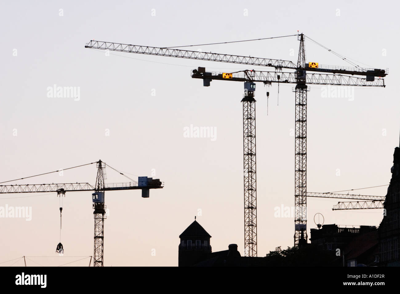 Construction cranes crowd the sky in downtown Hamburg - Stock Image