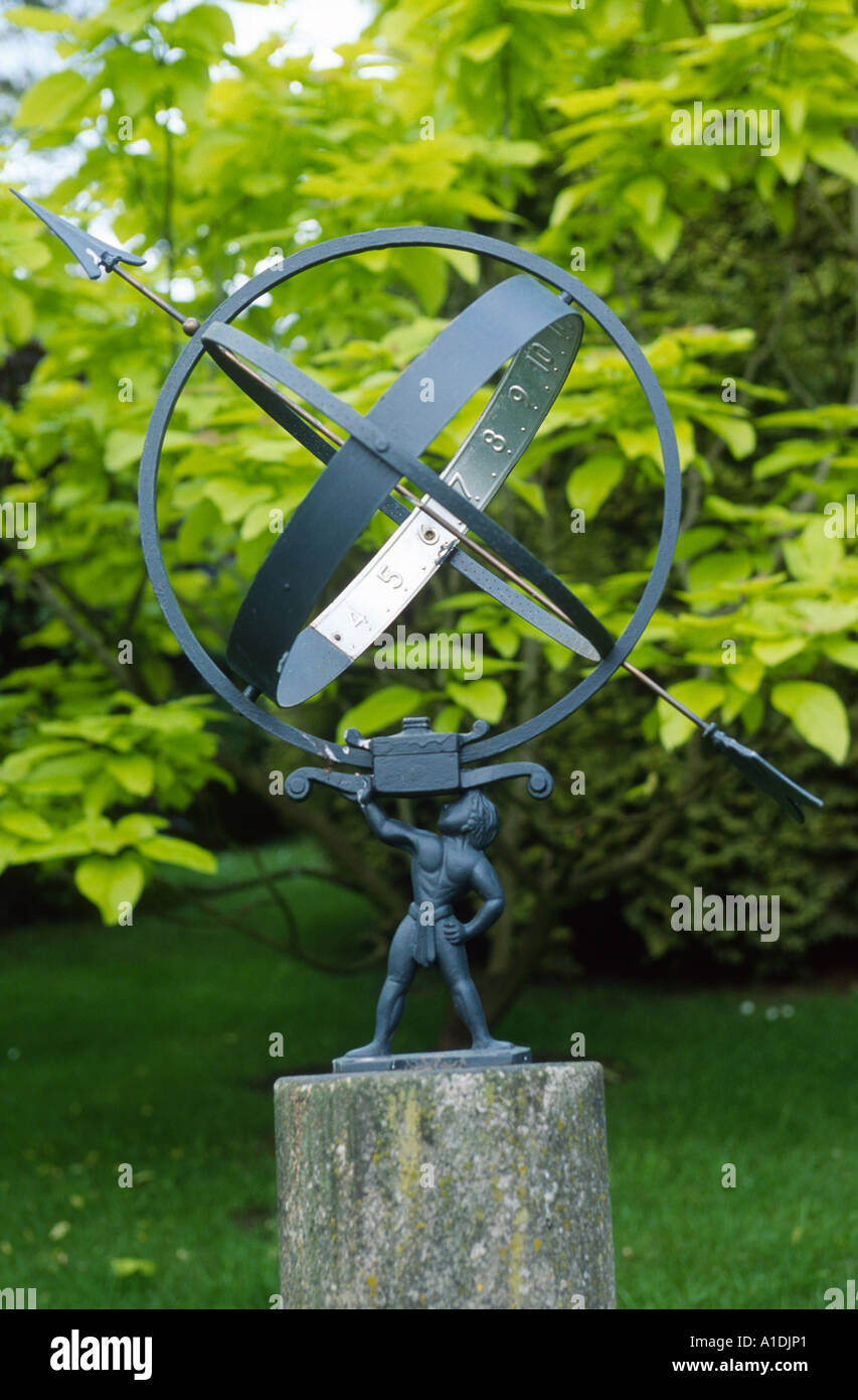 Armillary Sphere On Concrete Plinth In Large Garden   Stock Image