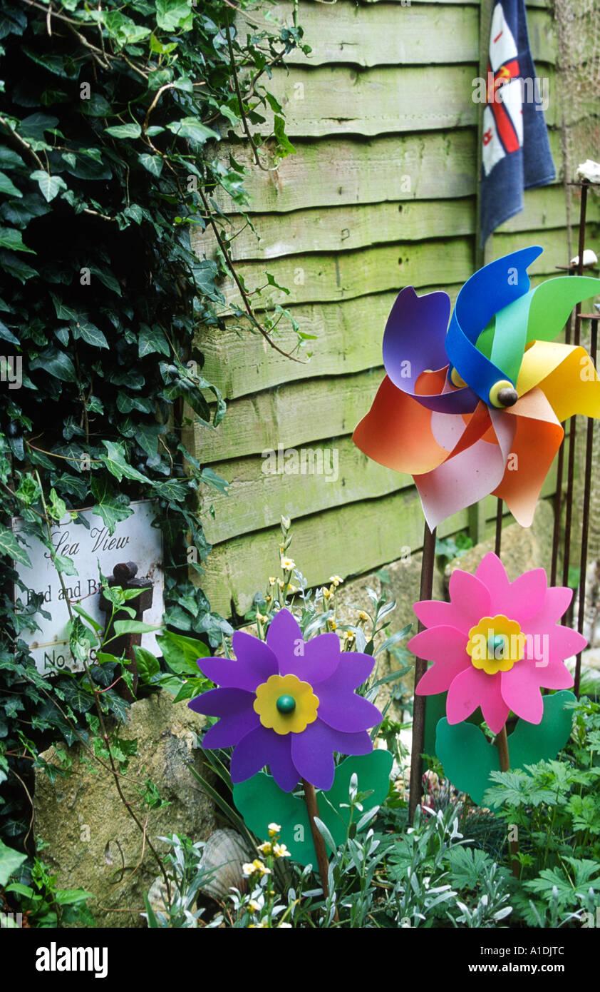 Plastic Windmills In Garden   Stock Image