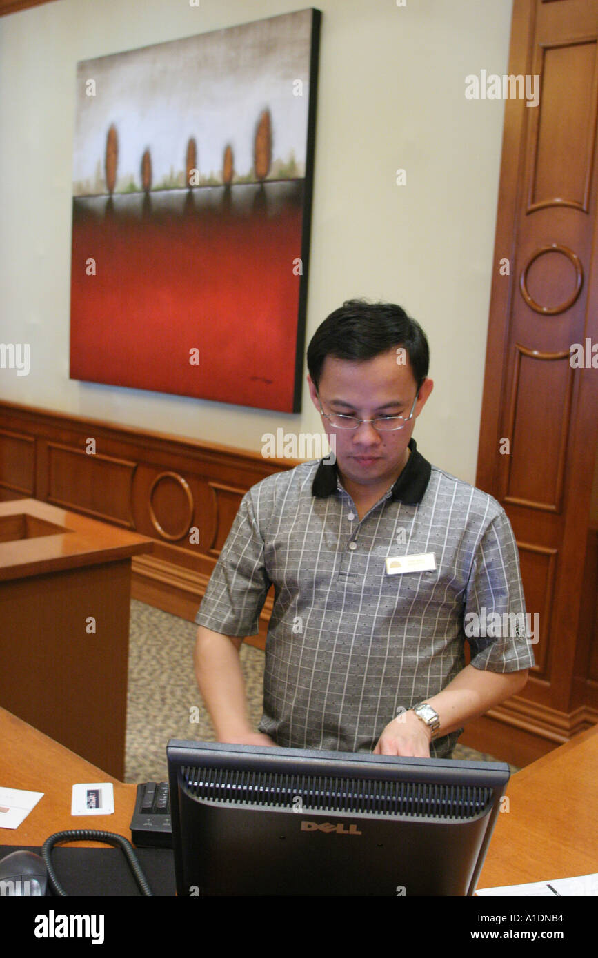 California Orange County Huntington Beach Hyatt Regency Resort and Spa Asian male reservations desk reception - Stock Image