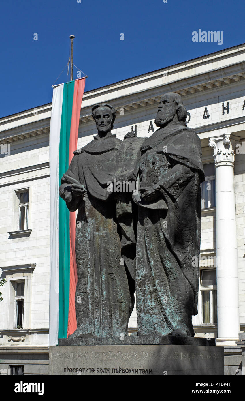 The Statues Of Saints Cyril And  Methodius With The National Flag Outside The National Library In Sofia The Capital - Stock Image