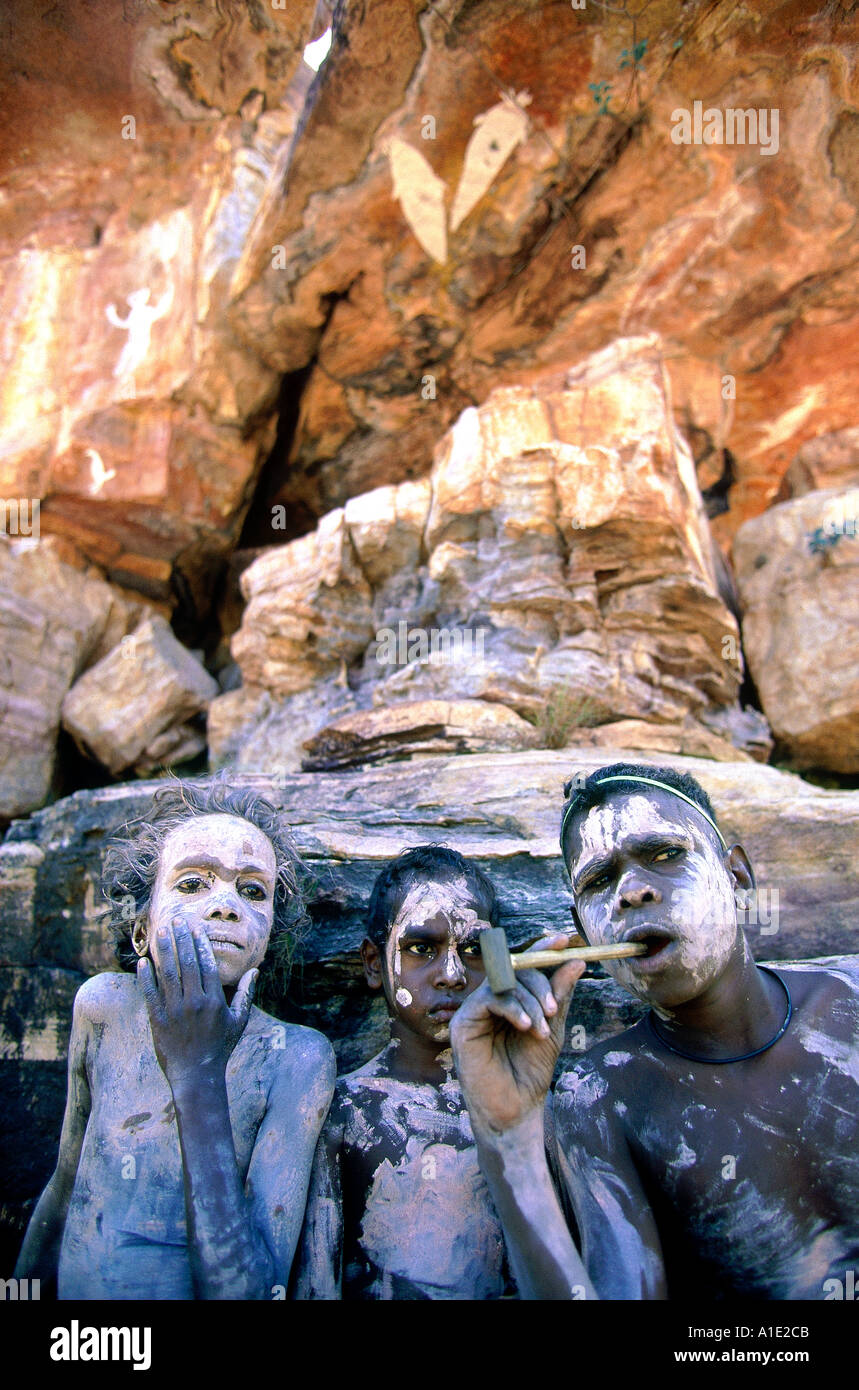 Aboriginal Rembargna clan boys paint up with white pipe clay when visiting significant sacred site Dukuladjarranj Arnhem land - Stock Image