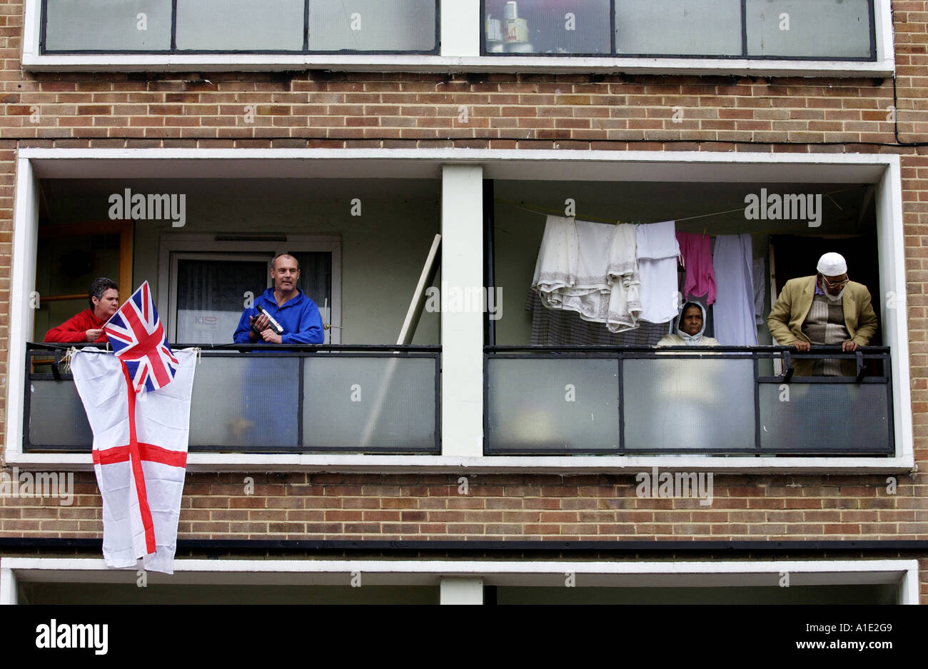 Tower block residents on their balconies East End of London UK Stock Photo
