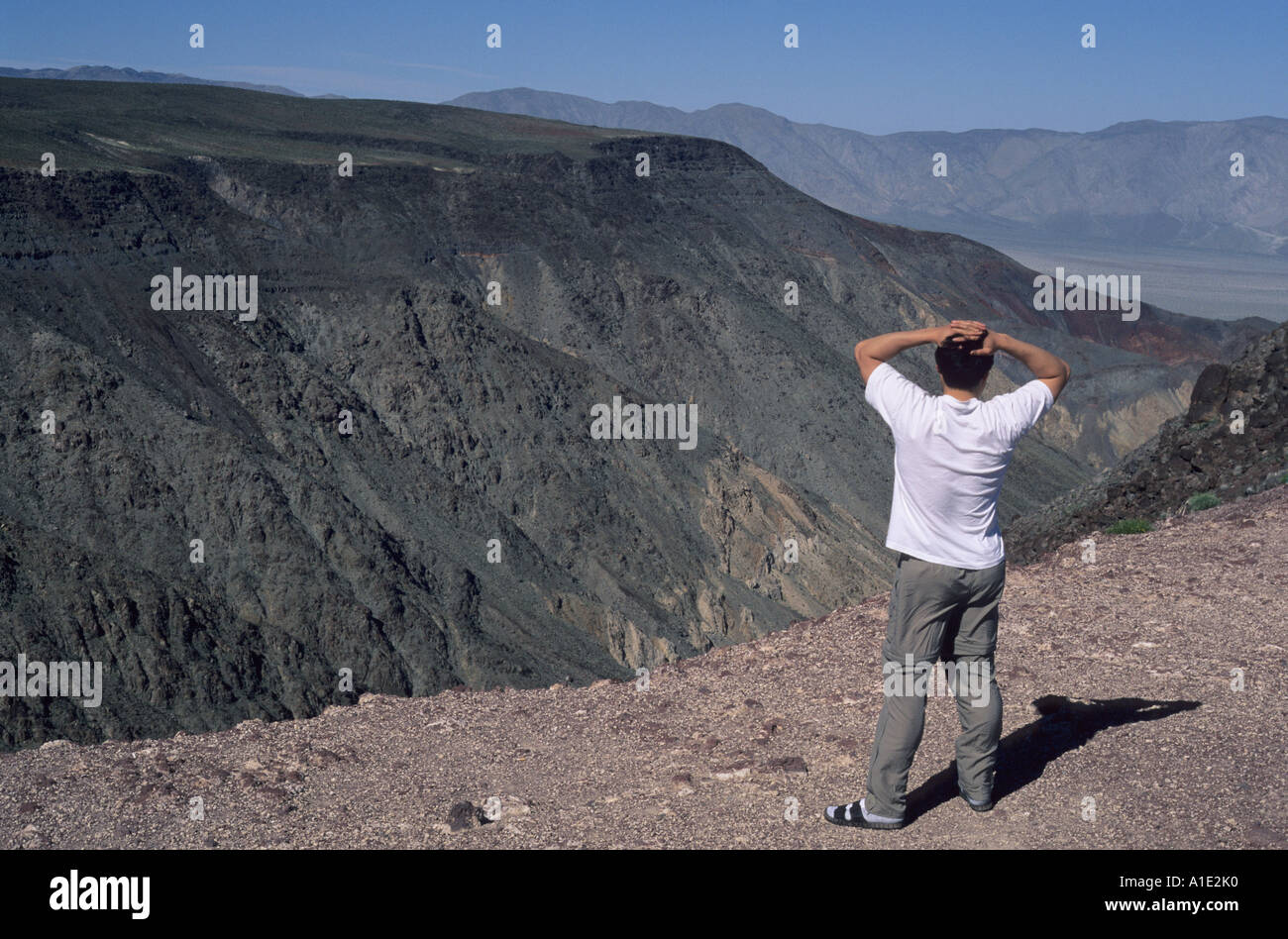 A tourist enjoys the view at Father Crowley Point Death Valley National Park California United States of AmericaStock Photo