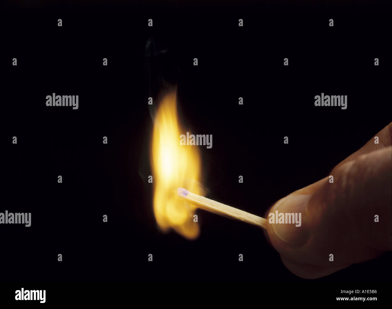 a match flaring after being struck - Stock Image