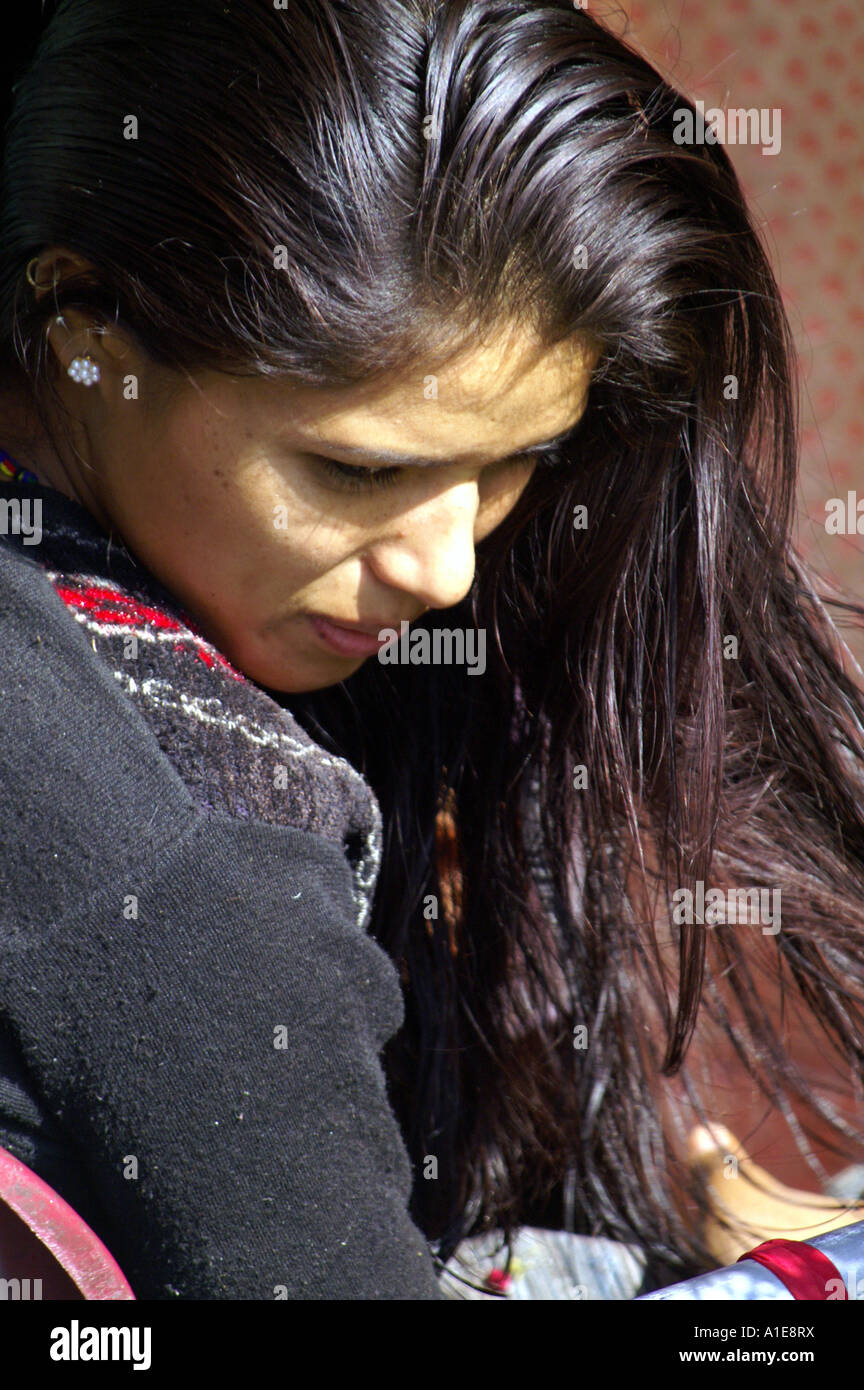 portrait of lovely pretty indian girl young woman combing