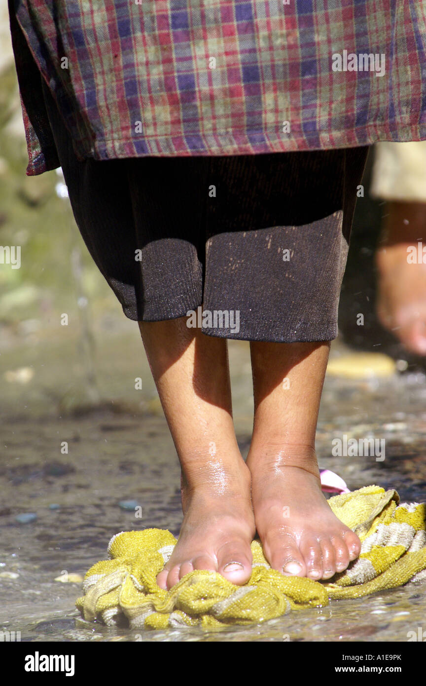 Small Indian Child Girl Doing Laundry In Public Vashist Hot Springs Feet Stepping Rug