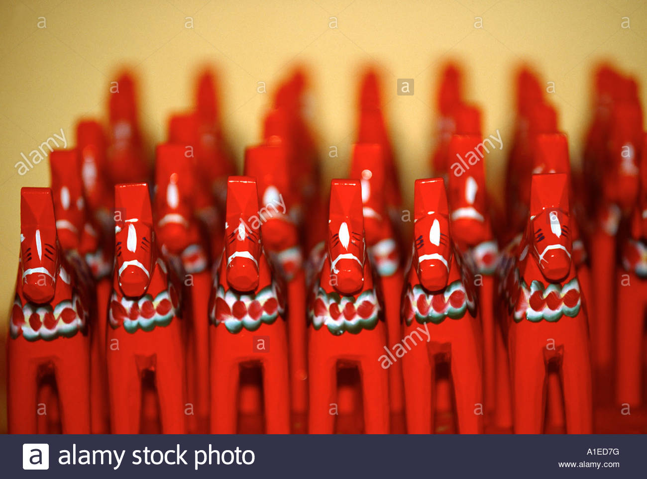 Group of red painted wooden horses - Stock Image