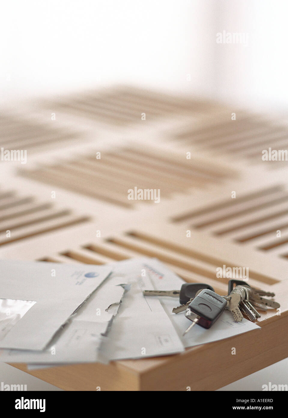 Open bills and keys on corner of table - Stock Image