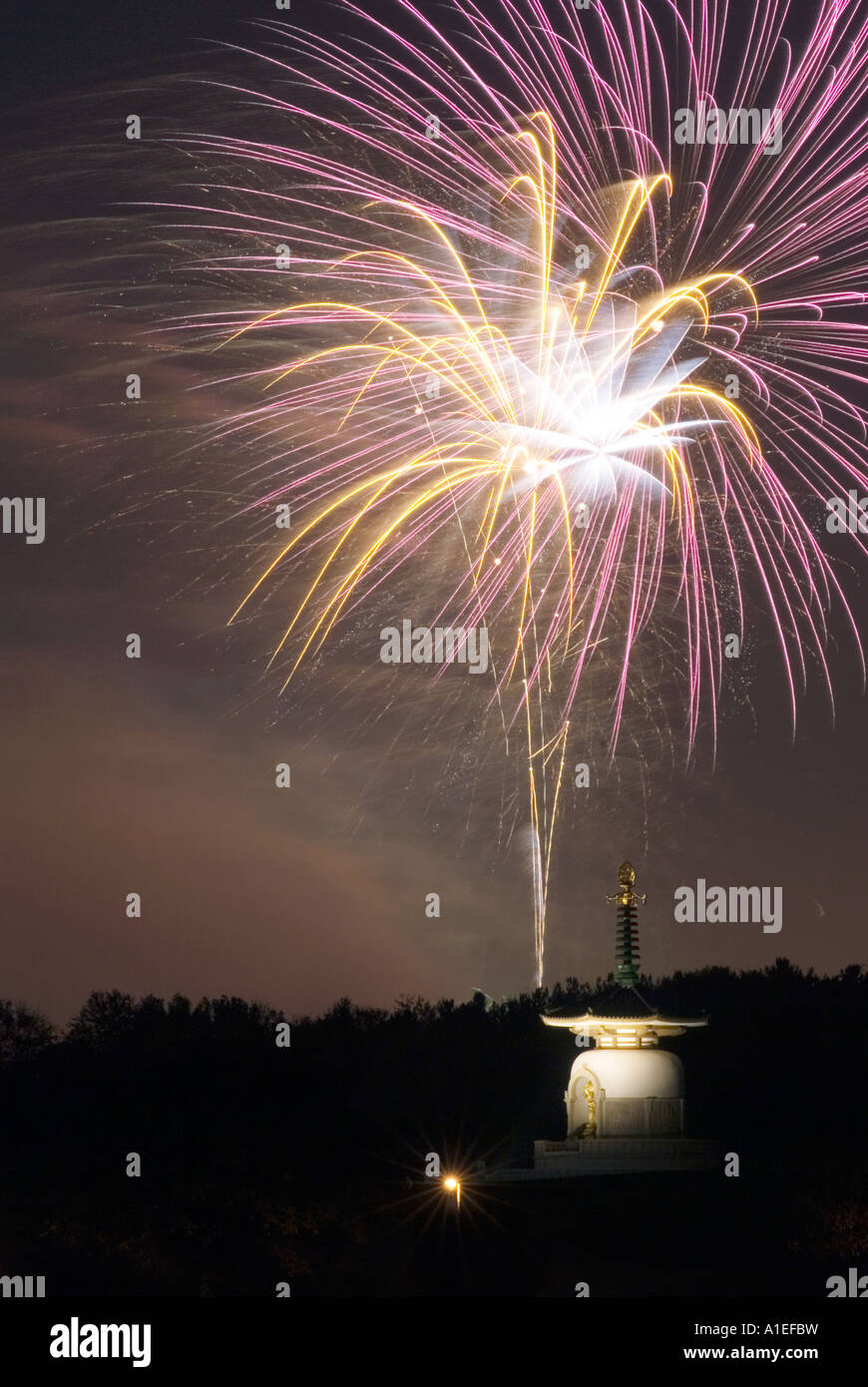 Central Milton Keynes firework display over the city of Milton Keynes Buddhist Peace Pagoda on Guy Forks night - Stock Image