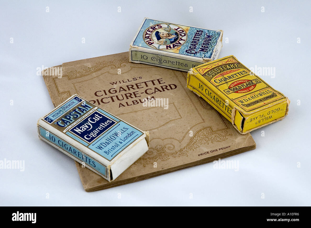 A collectors old and historical cigarette packets and album all containing collectable picture cards from the 1930 - Stock Image