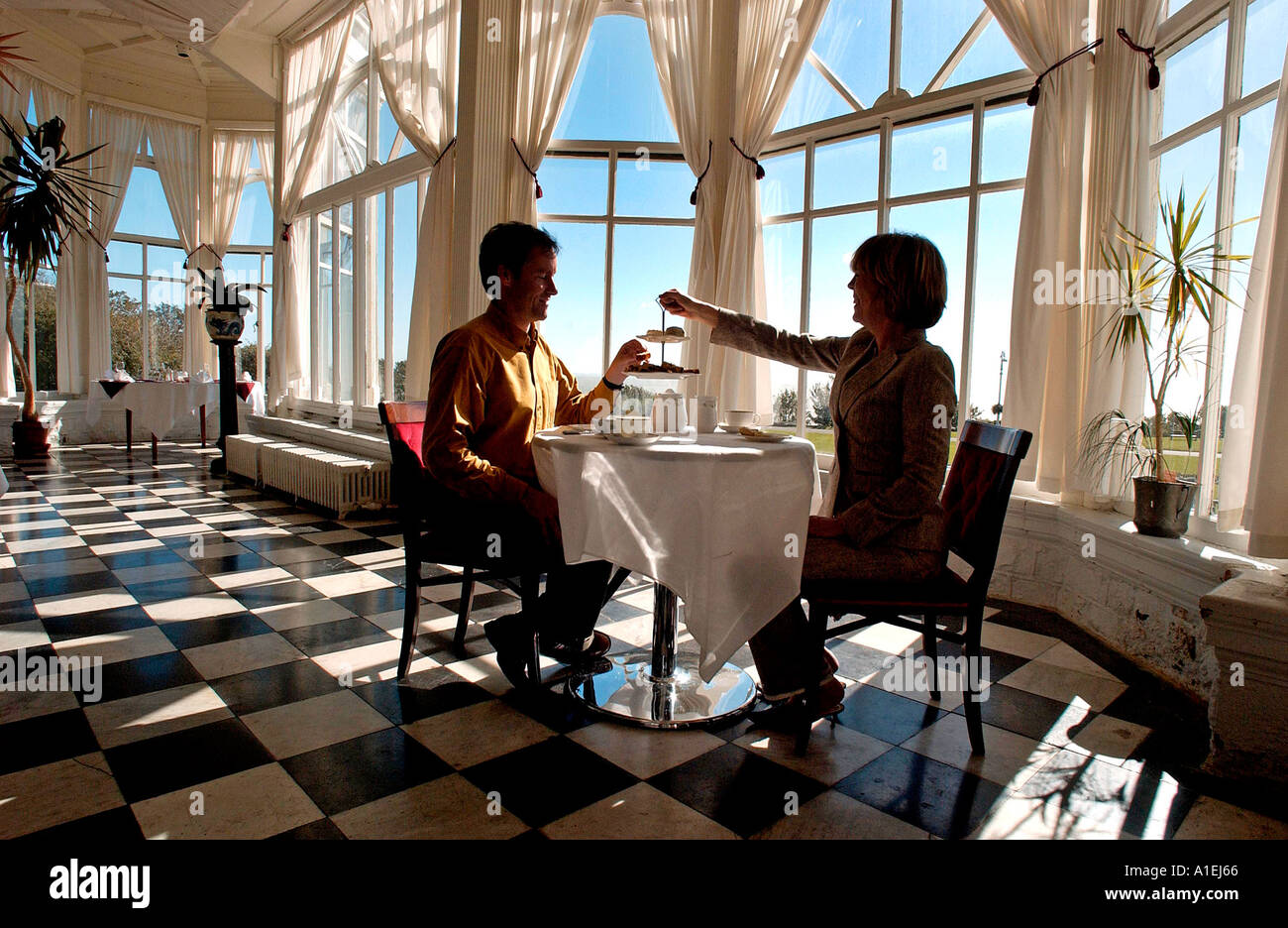 Tea for two at a grand old seaside hotel - Stock Image