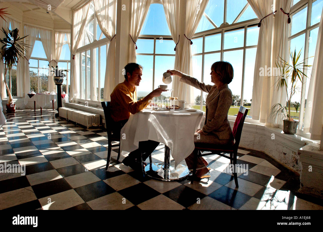 Traditional tea for two at a grand old seaside hotel - Stock Image