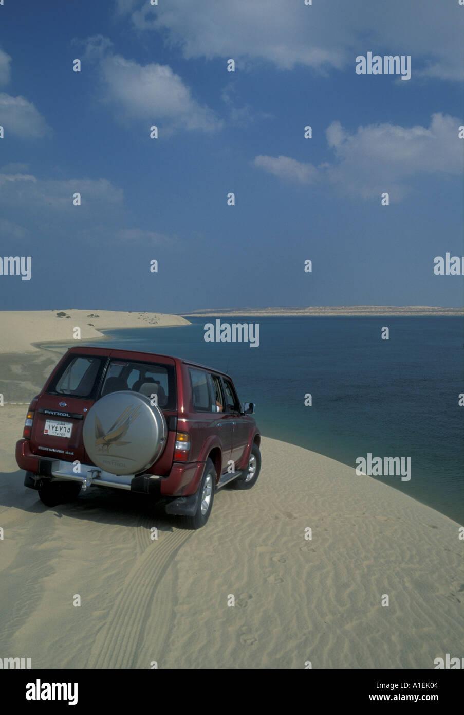 QATAR a four-wheel drive overlooking Khor al Udeid, the inland sea - Stock Image