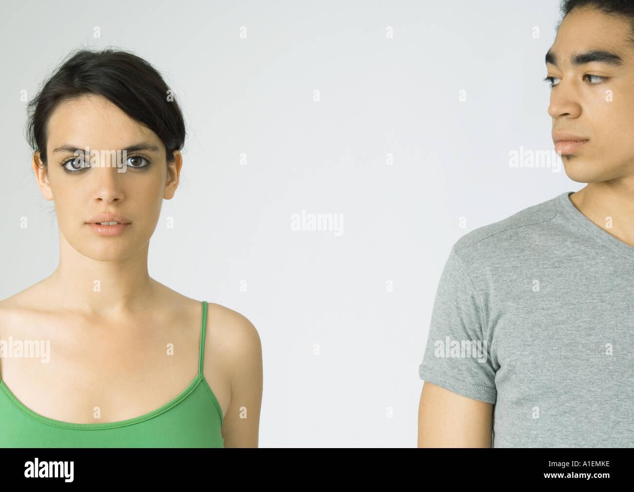Young couple, woman looking at camera, man looking at woman - Stock Image