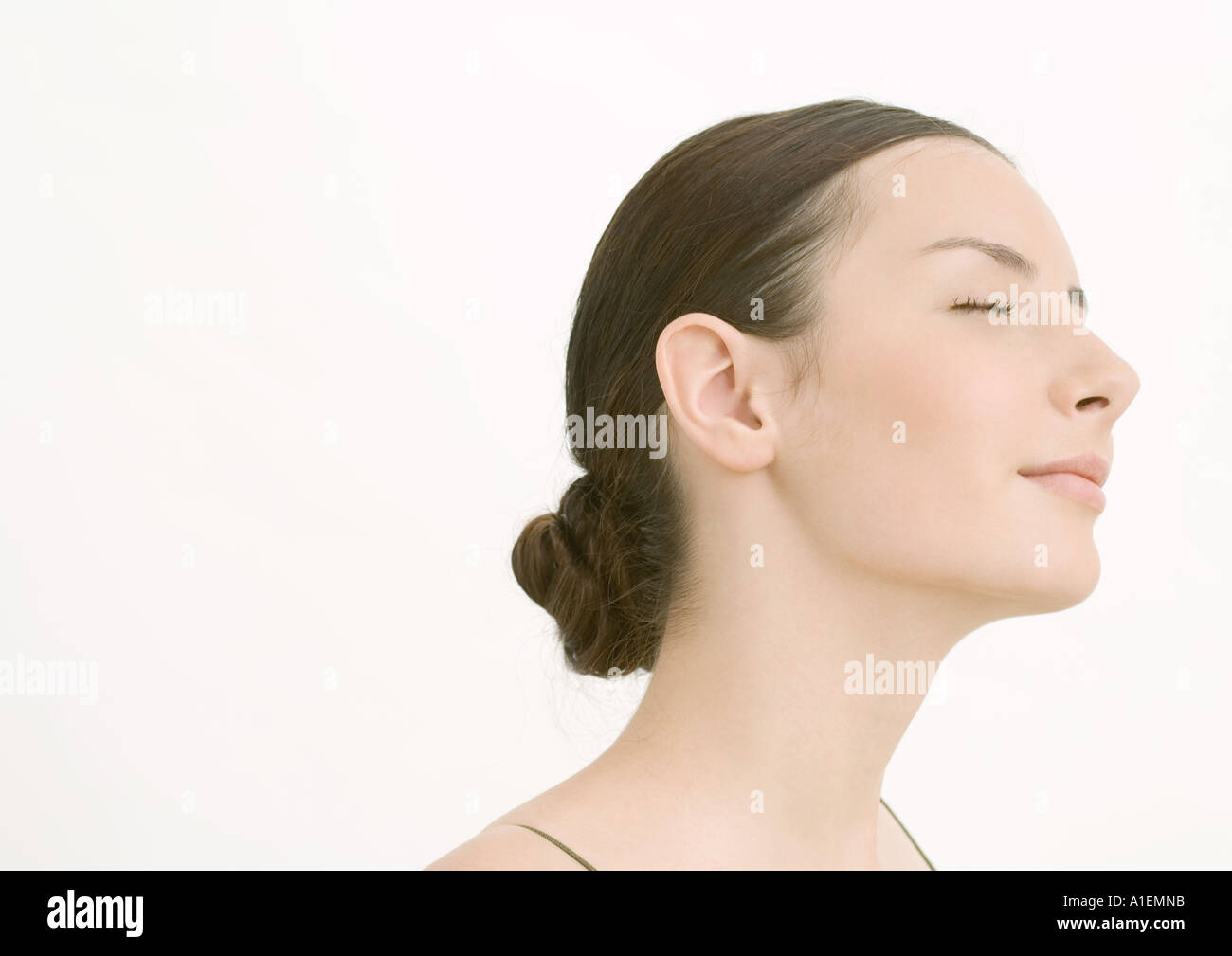 Young woman closing eyes - Stock Image