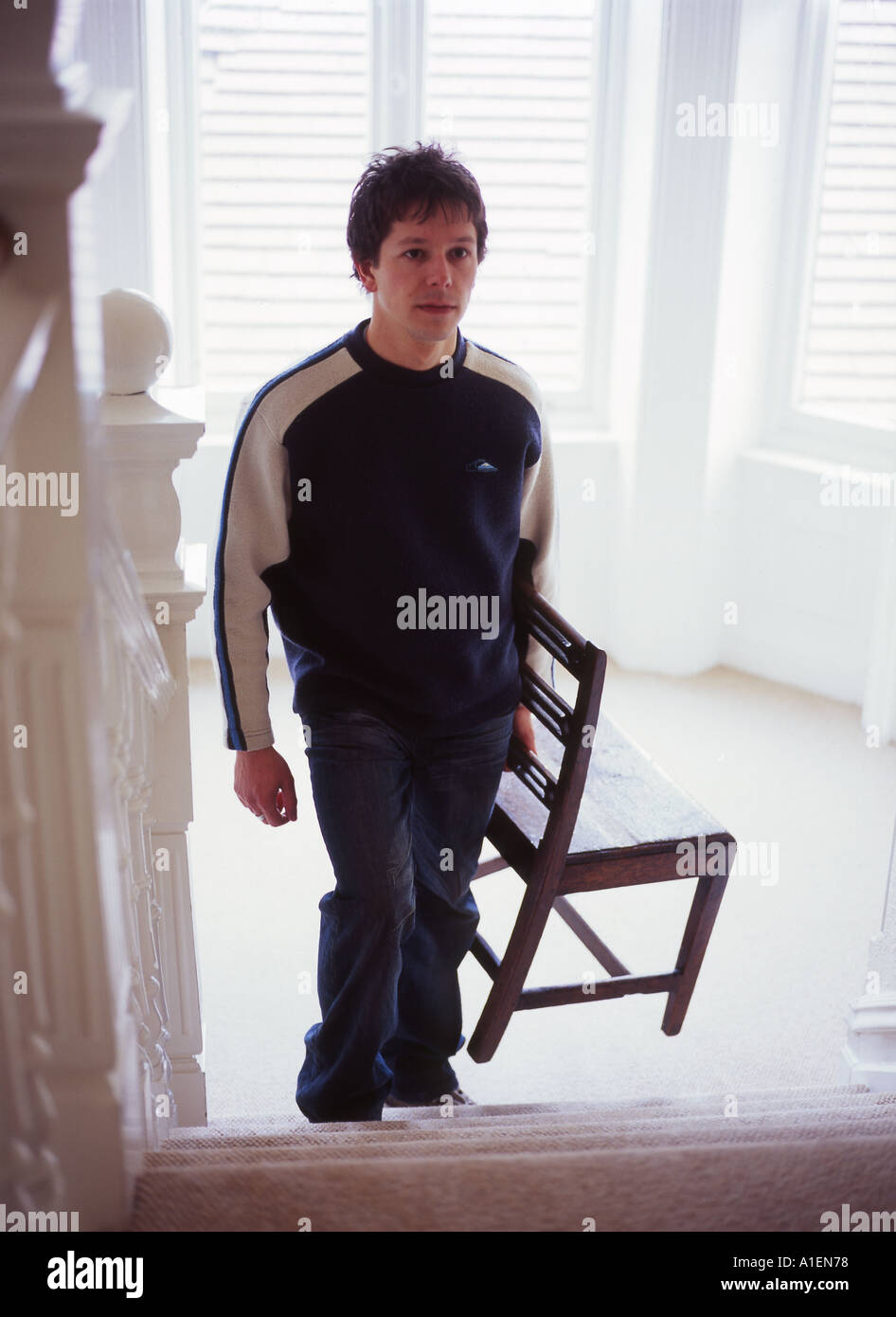 Man Carrying Chair Up Stairs Stock Photo 3341687 Alamy