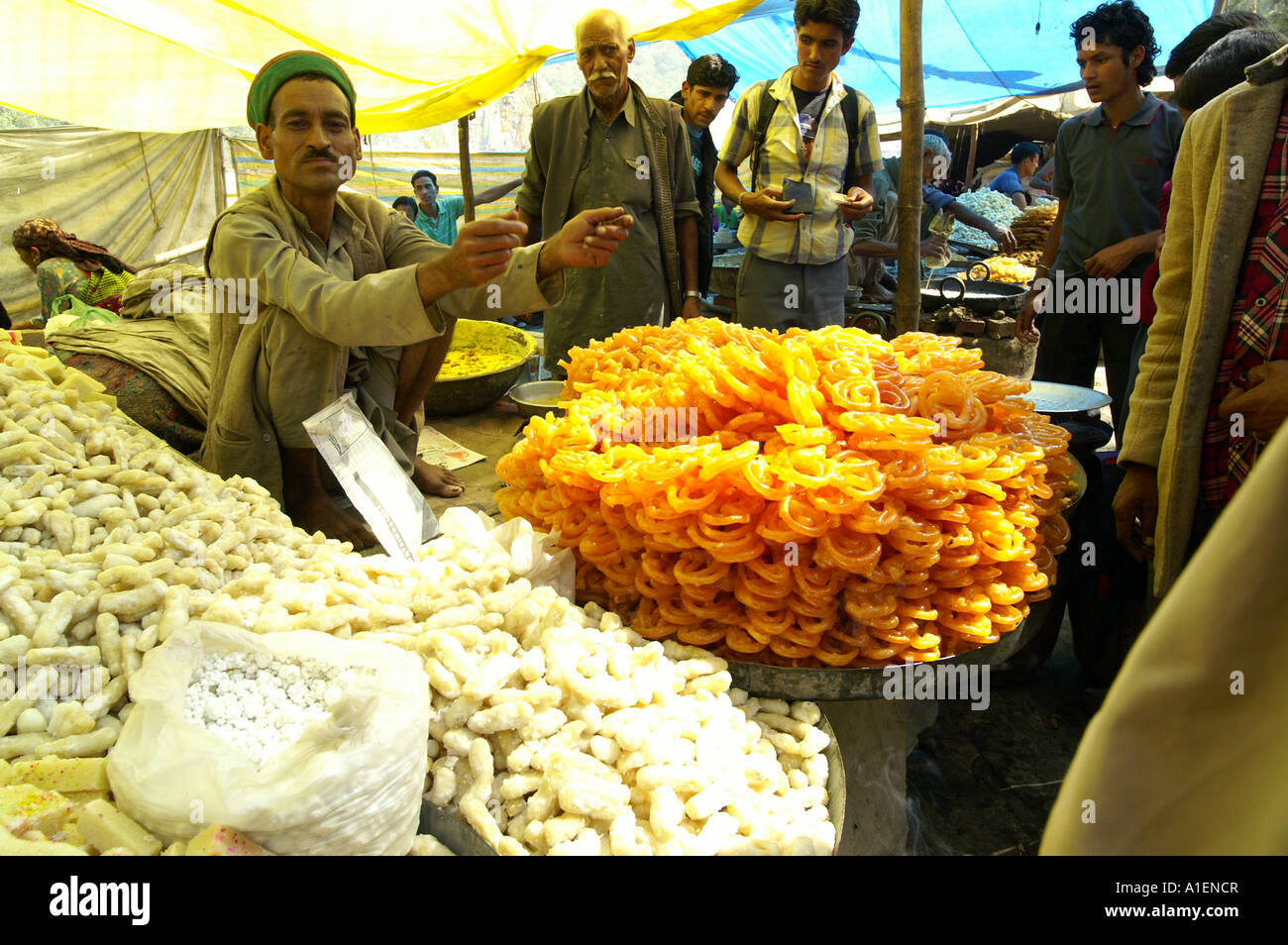 Stalls with pretzel at Dussehra fair with enormous variety of rich Indian cuisine meals, Kullu, India - Stock Image