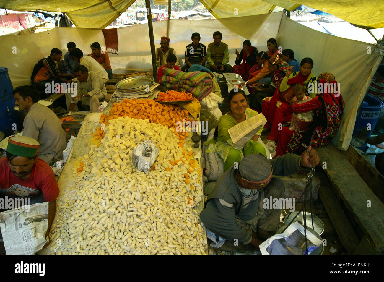 Stall with sweets at Dussehra fair with enormous variety of rich Indian cuisine meals, Kullu, India - Stock Image