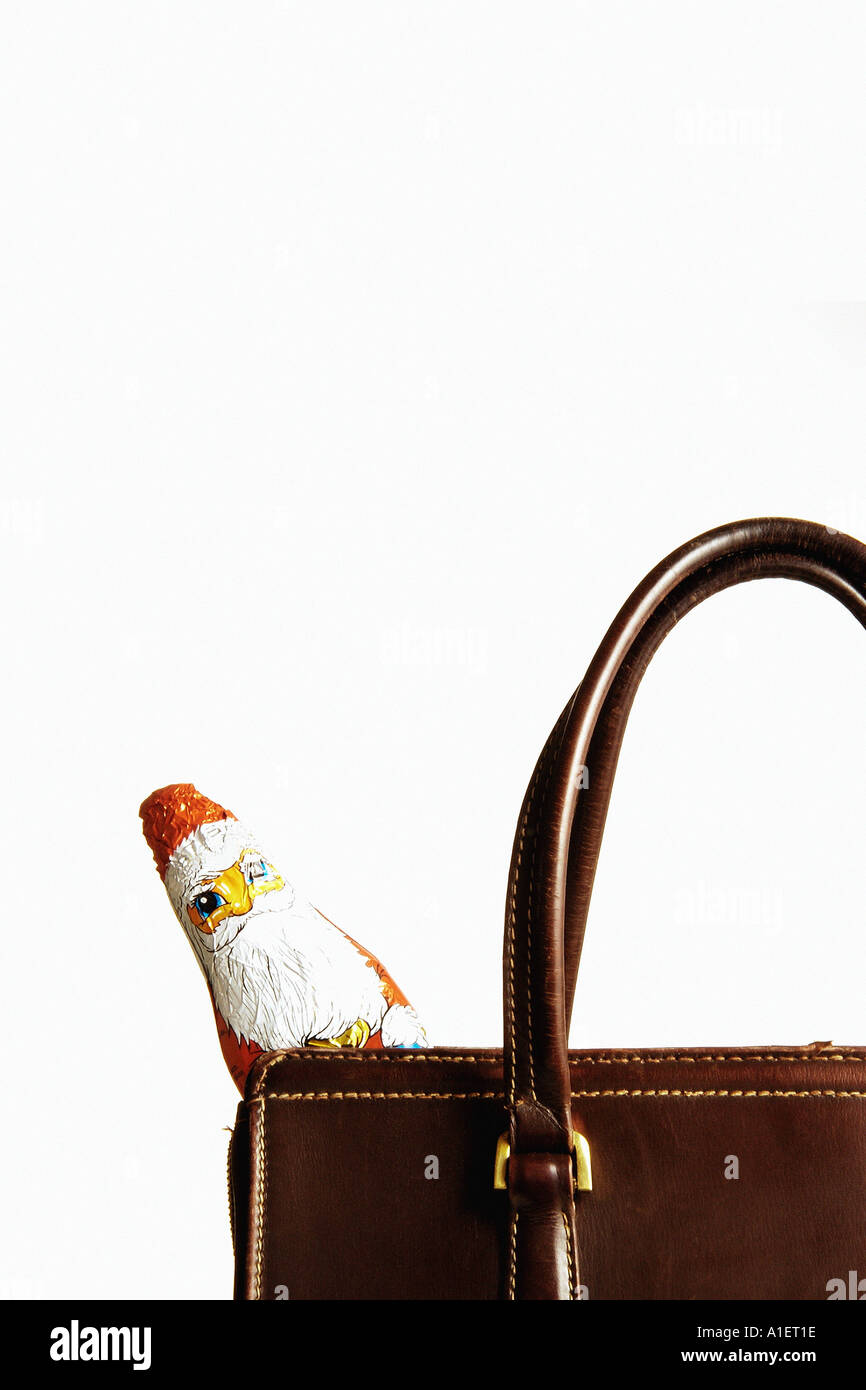 Chocolate Santa Claus in handbag - Stock Image