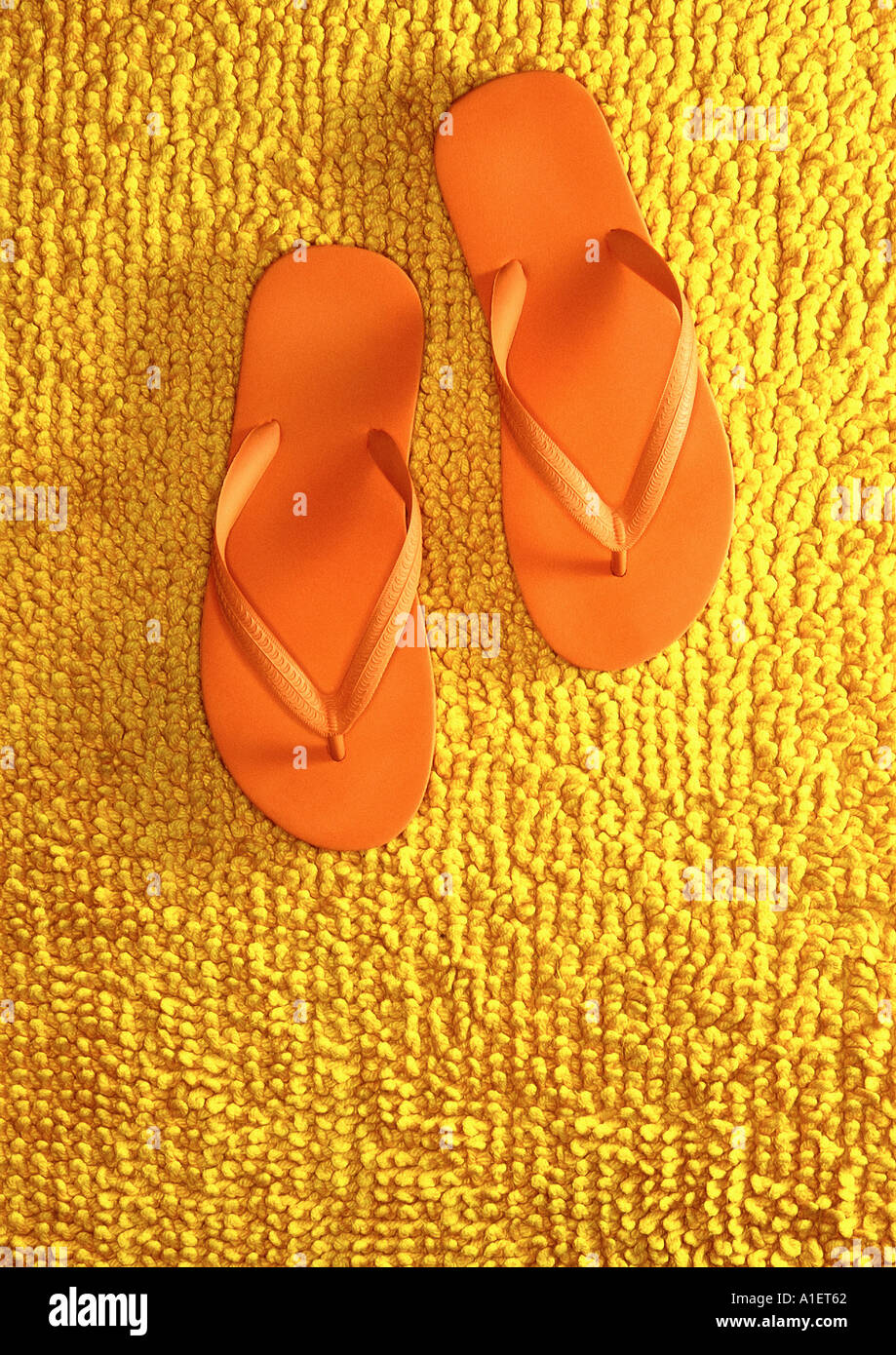 Pair of orange flip flops - Stock Image