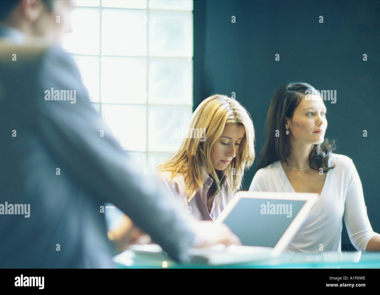 Two women and man in office - Stock Image