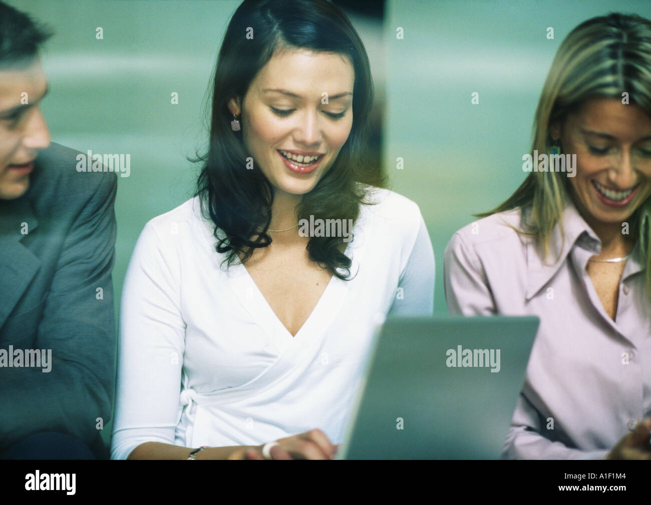 Three businesspeople side by side - Stock Image