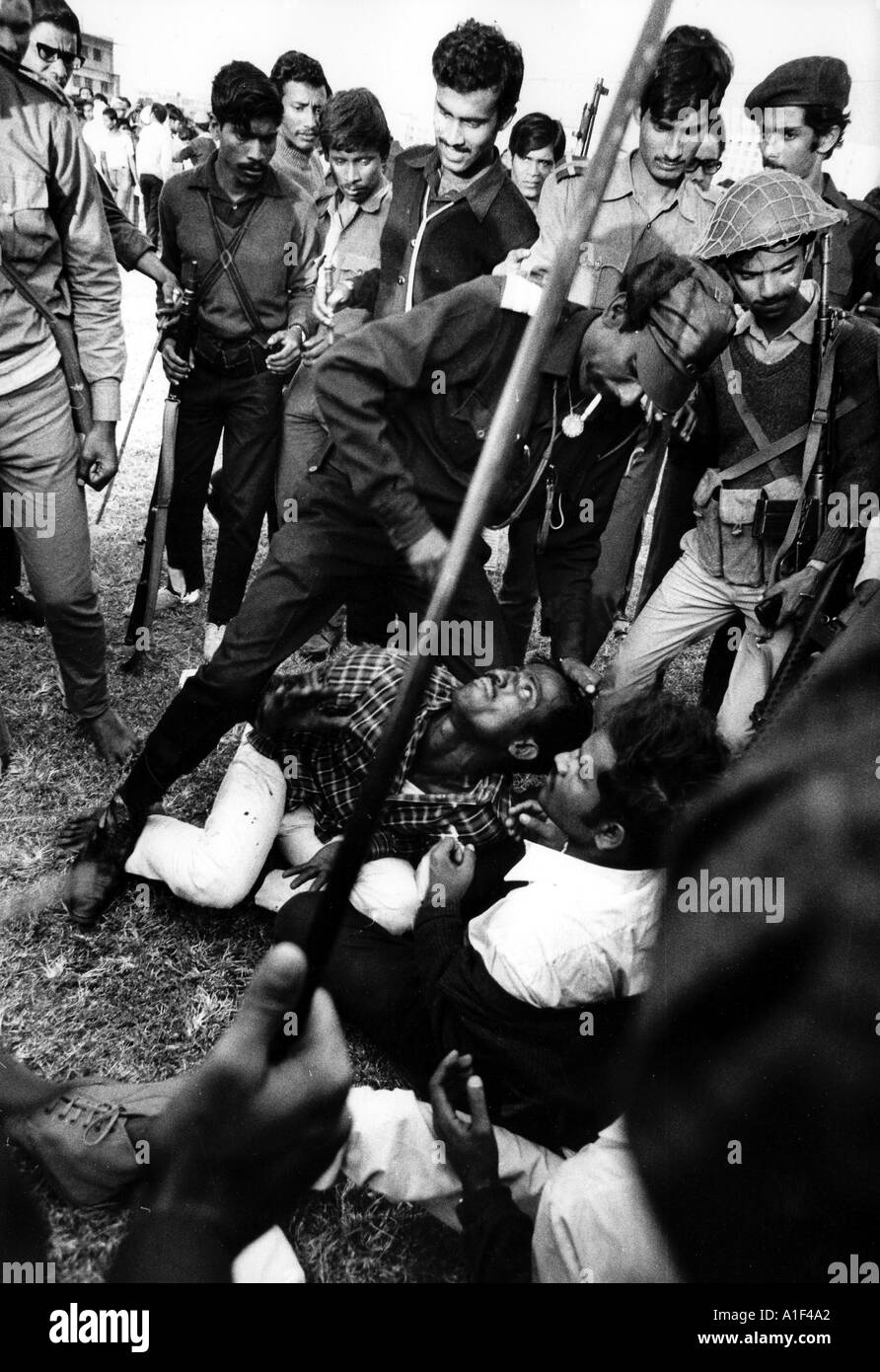 During victory rally in Dacca stadium the Mukti Bahini torture and bayonet 5 young men 4 killed Collaboraters  - Stock Image