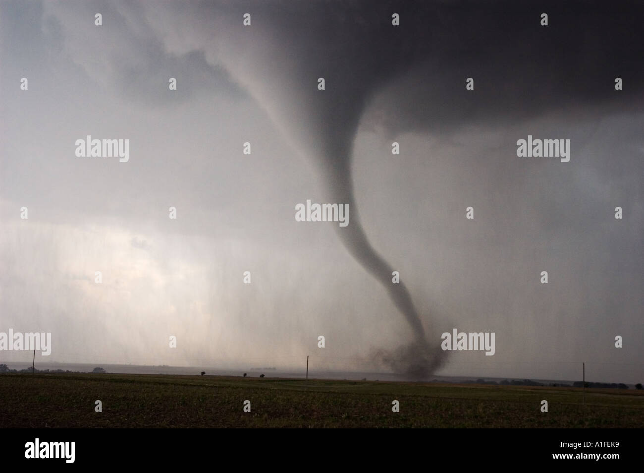 A classic tornado right from the 'Wizard of Oz' sweeps across the Kansas prairie near Wakeeney on June 9th, 2005. - Stock Image