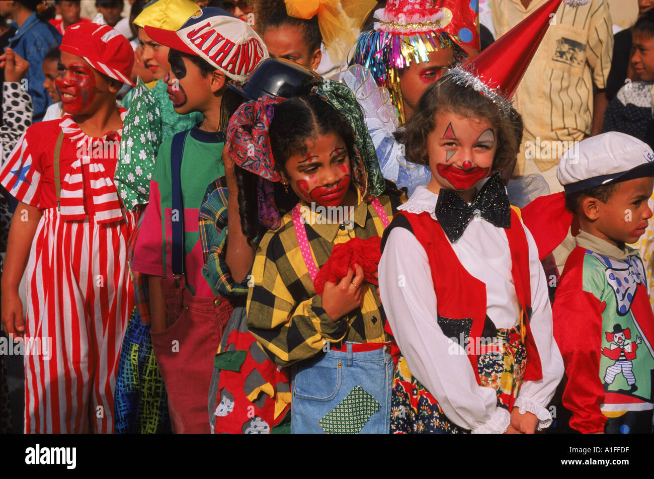 Portrait of children with painted faces during the Mardi Gras Festival in the city of Mindelo on Sao Vicente Island Cape Verde - Stock Image