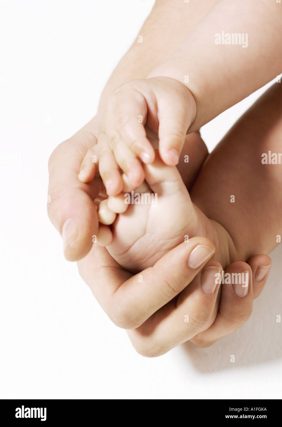 Woman holding baby's foot Stock Photo