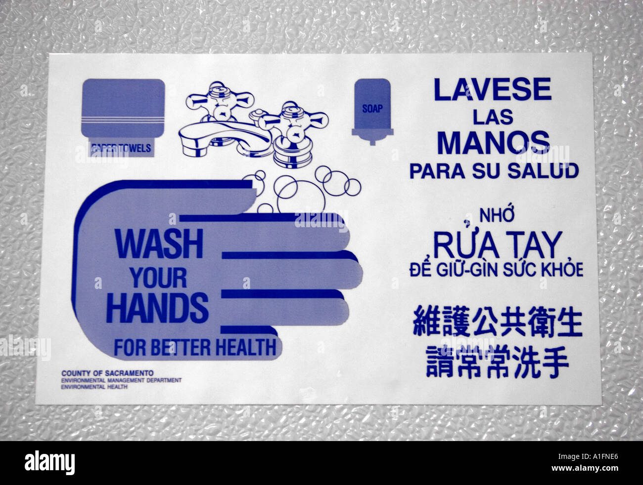 Wash your hands sign in a bathroom showing different languages Stock Photo: 3344869 - Alamy