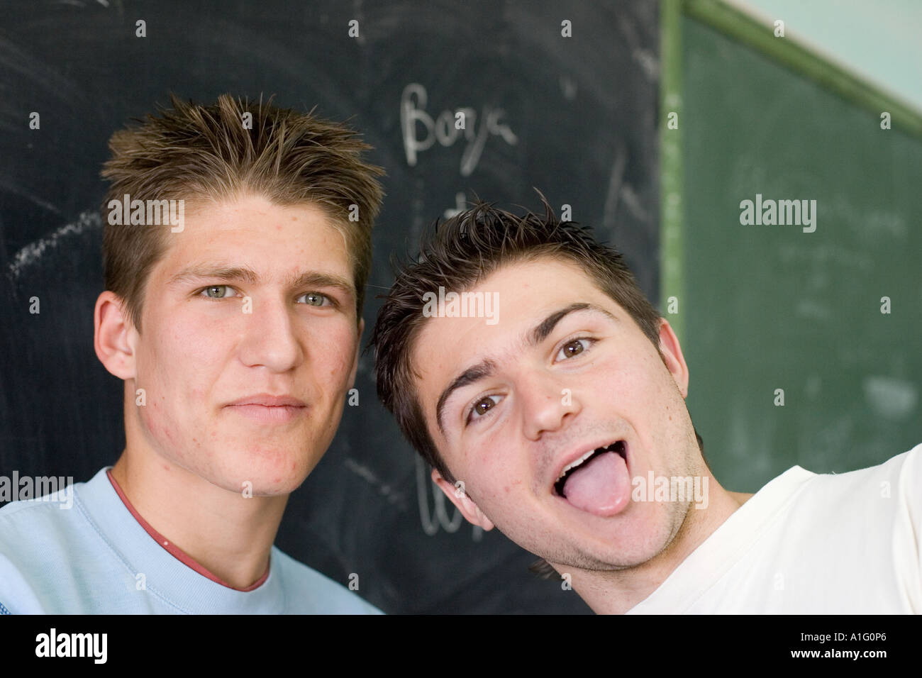 Teenager students in their classroom - Stock Image