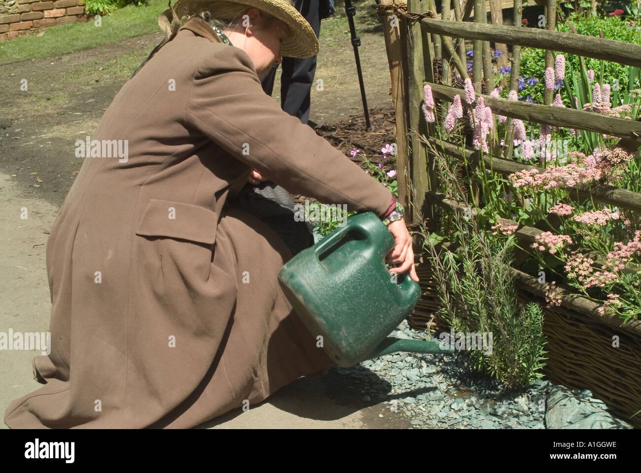kim wilde garden designer watering the cumbrian fellside garden a courtyard garden stock image - Wilde Garden