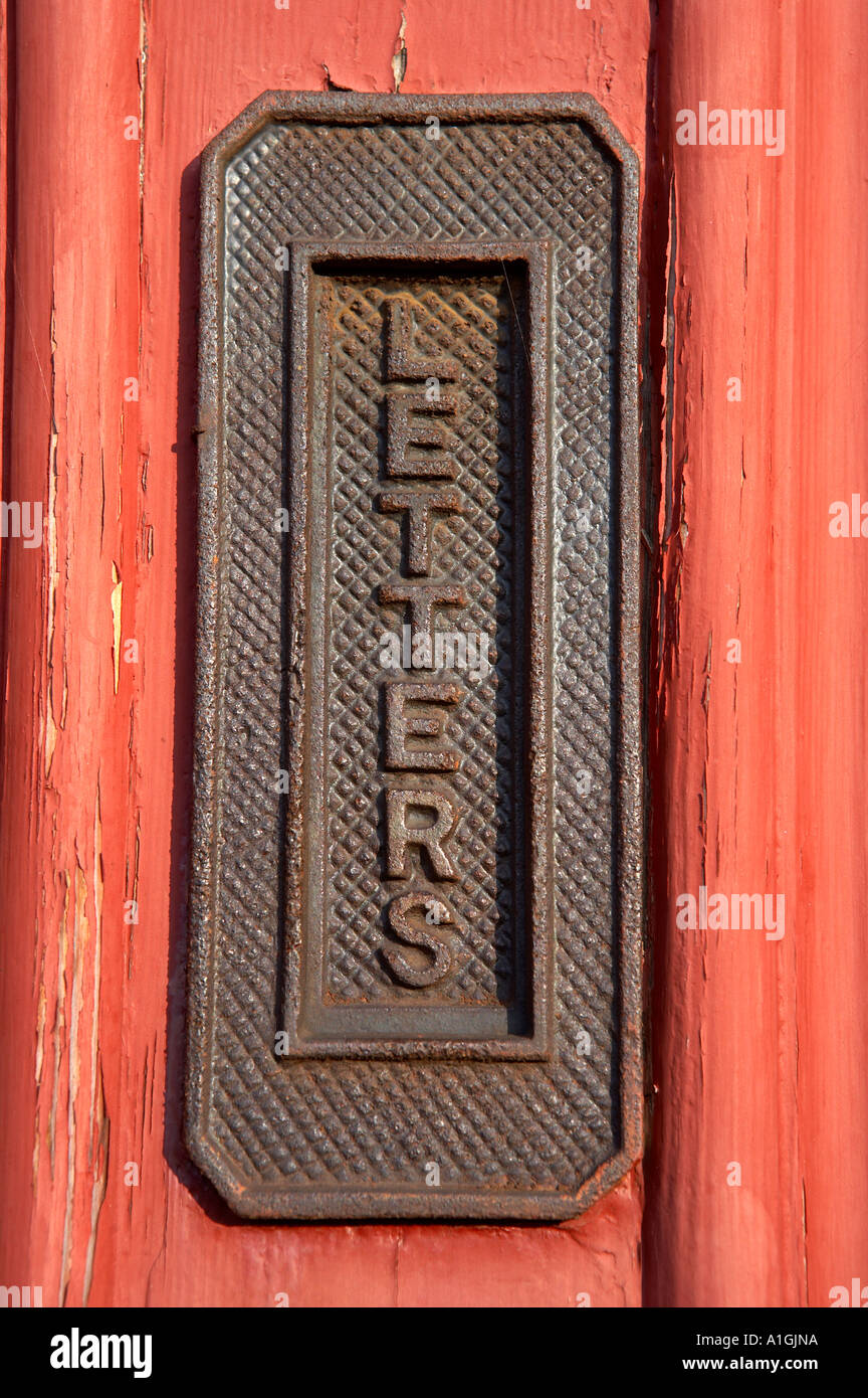 Vertical letter box in a red wooden door, blist hill Victorian museum, Shropshire, England uk - Stock Image