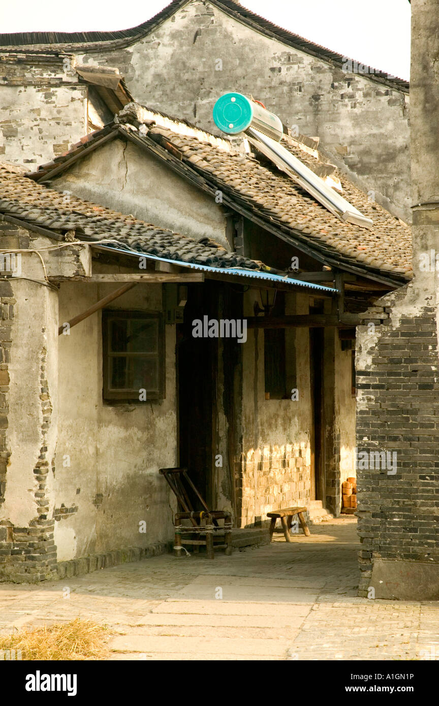 Village Home With Solar Water Heater On Tile Roof, Xitang, China