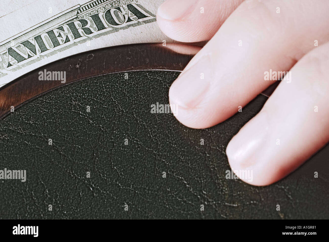 Hand On Open Purse With Dollar Bill - Stock Image