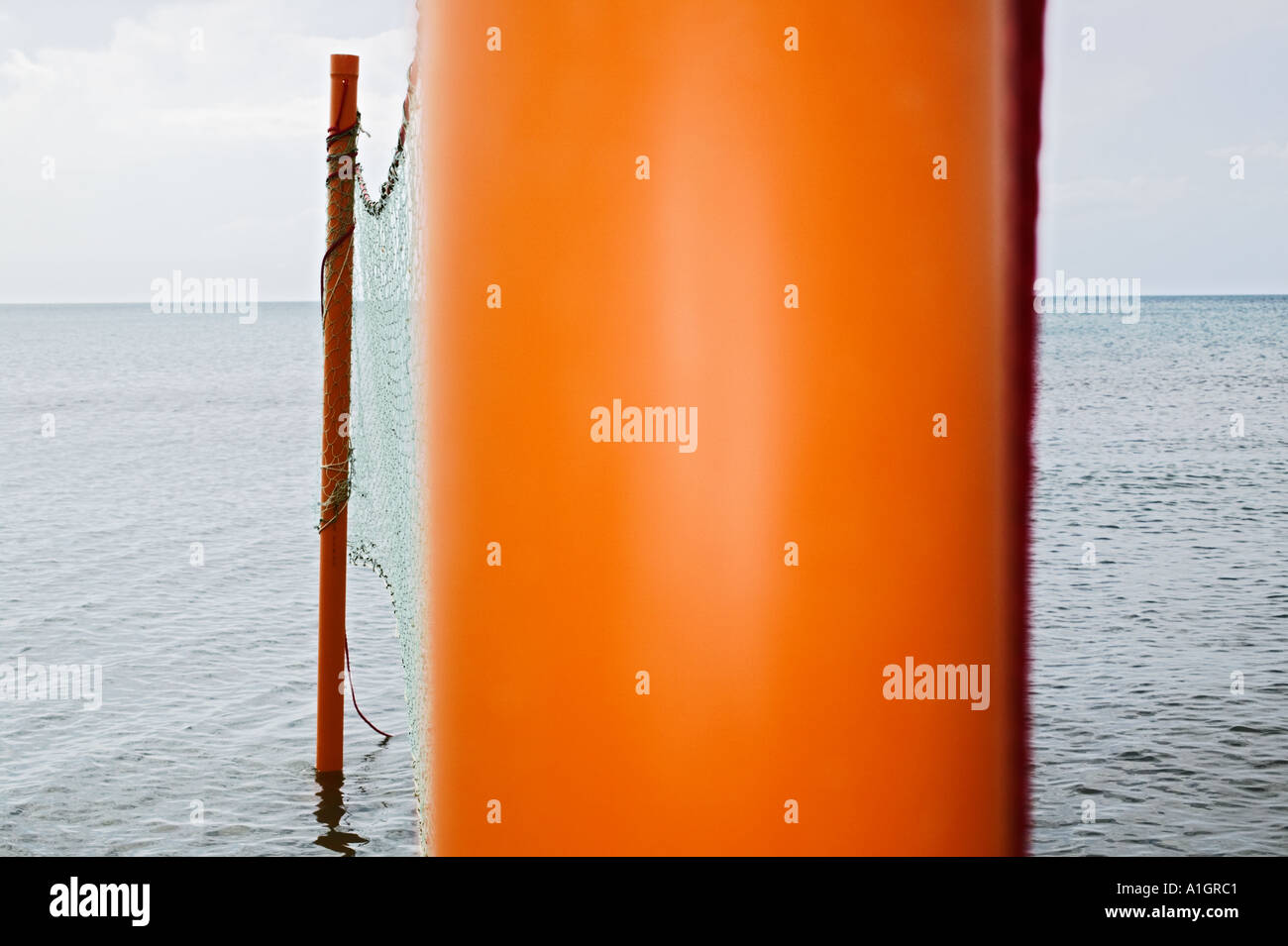 Volleyball Net In Water - Stock Image