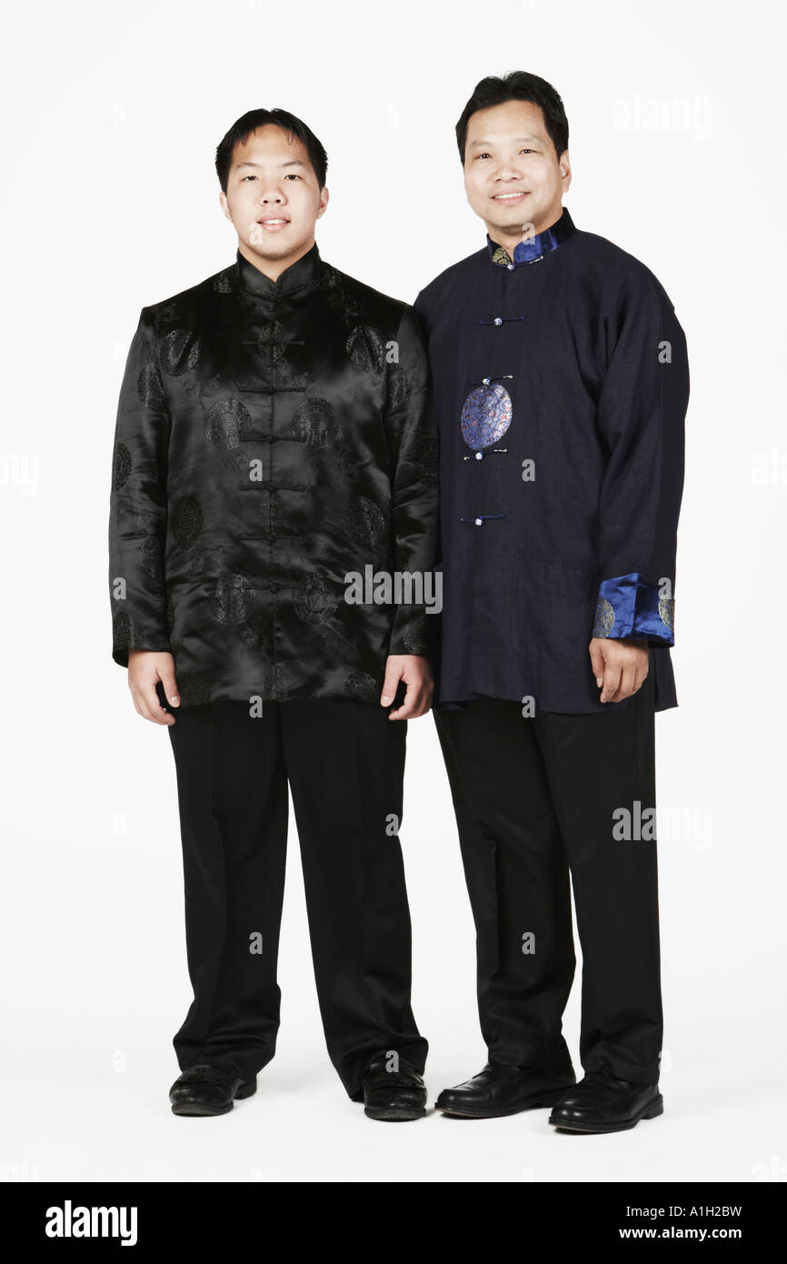 Portrait of a father and his son standing - Stock Image