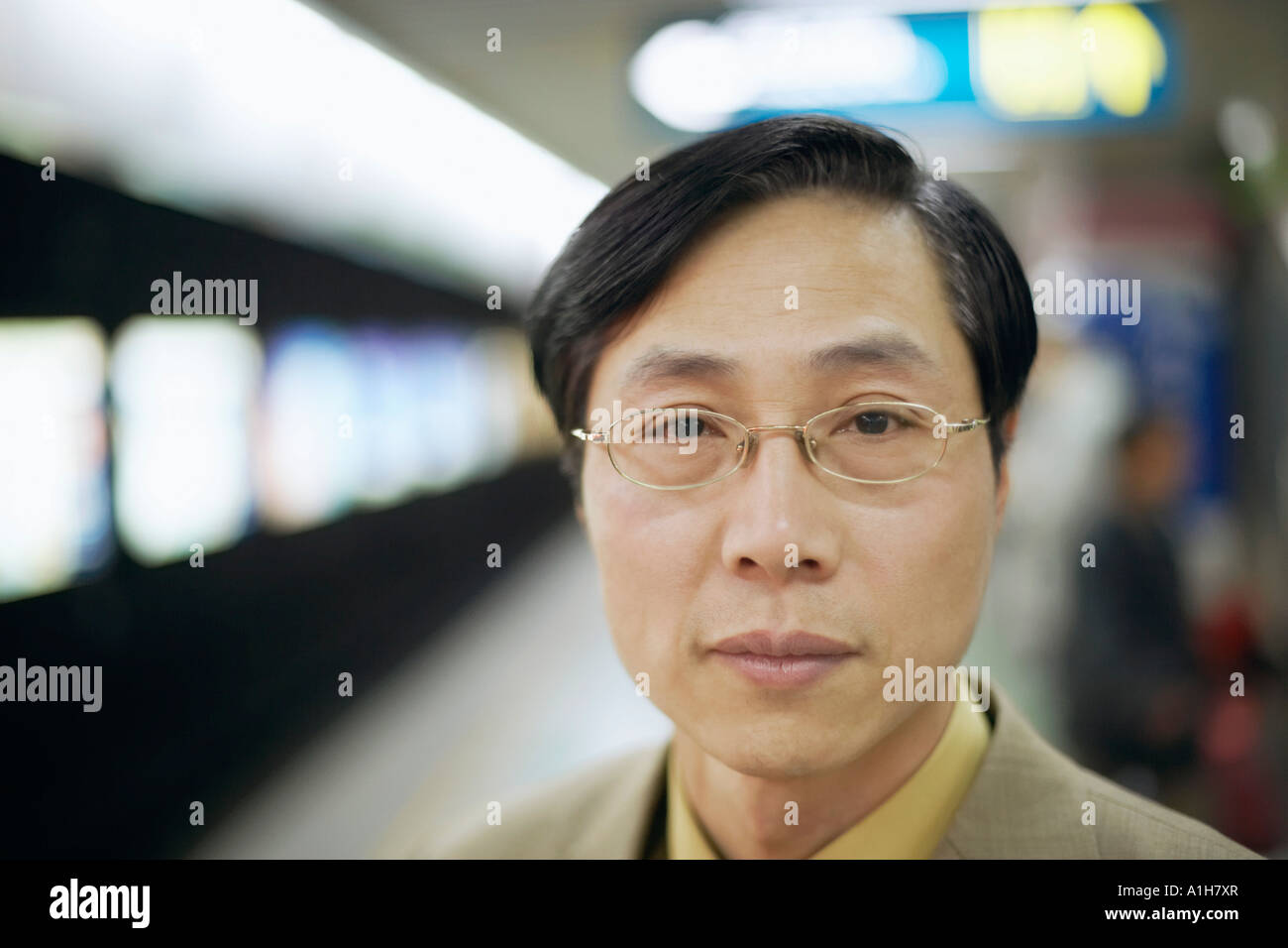 Portrait of a businessman at a subway station - Stock Image